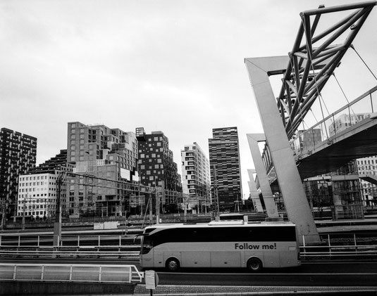 barcode high-rise buildings and a bus