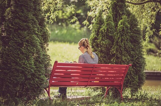 Calm woman on park bench.