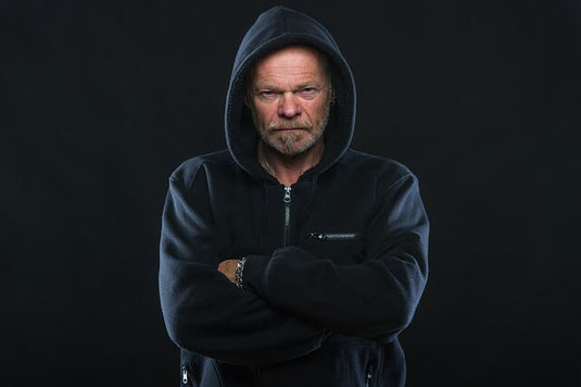Angry man in hoodie.