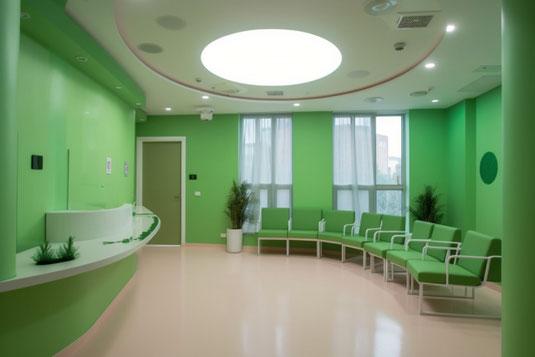 水の入ったグラス。歯磨き粉のチューブ。白と青のストライプの歯磨き粉が載った水色の歯ブラシ。