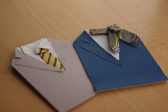 男性と女性のビジネスウェアのペーパークラフト。スーツにネクタイ。ジャケットにスカーフ。