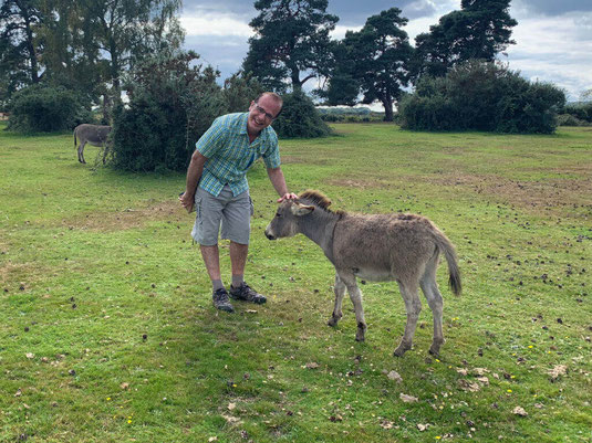 Choirmaster Martin making friends with a donkey.