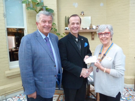 Members of Poole Rotary presenting a cheque to the Music Director of Wessex Chorus.