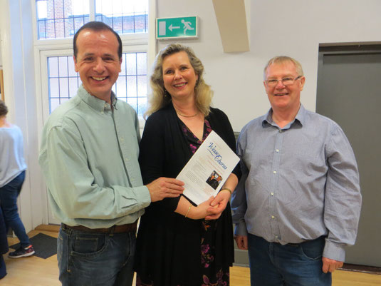 Gaynor Keeble smiling with the Music Director and chairman of the Wessex Chorus community choir.