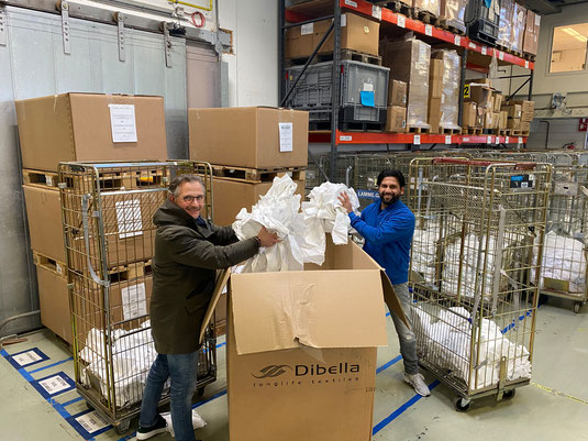 """Six tons of bed linen, towels and napkins on the way to a new """"life"""". Owner Jan Lamme (left) and Assistant Operations Manager Frank David are collecting for more sustainability in the textile service. Copyright: Lamme Textile Management"""