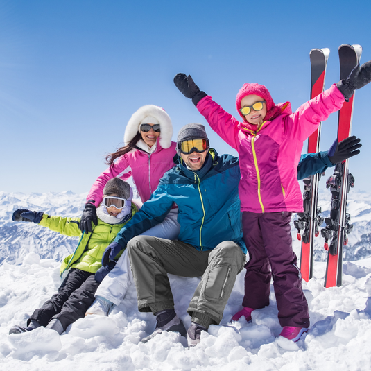 Family group photo on ski holiday in the snow