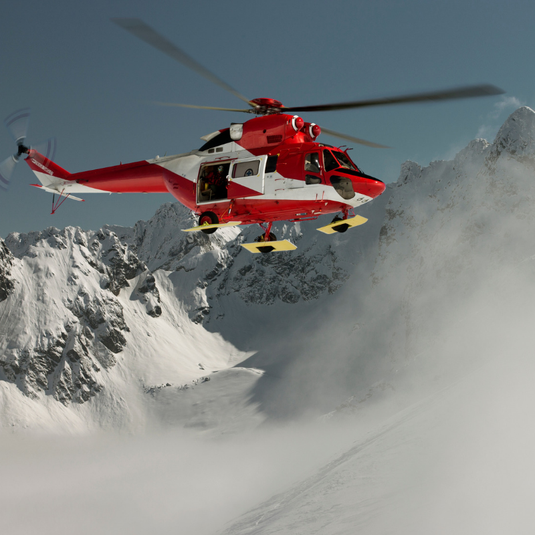 Mountain Rescue helicopter in mountains