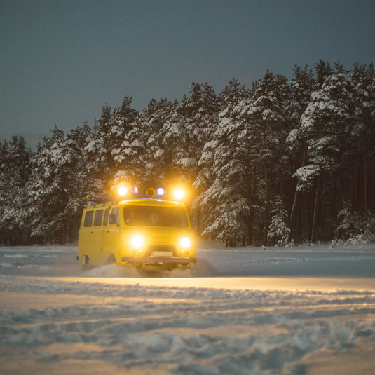 Taxi van driving in snow