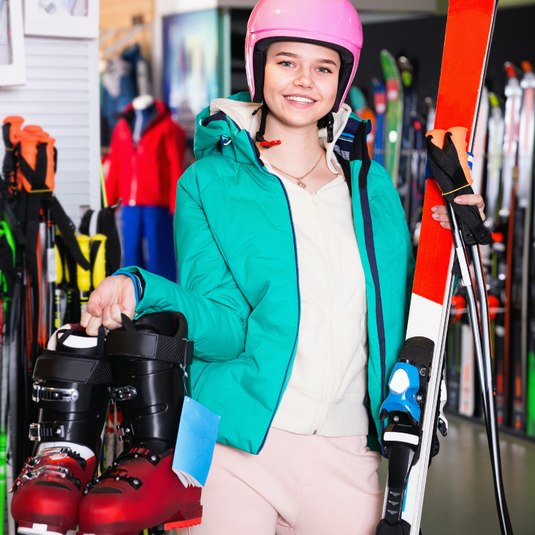 Young girl in ski rental shop