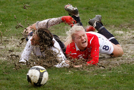 U.S. Carli Lloyd (L) fights for the ball with Norway's Solveig Gulbrandsen during their Algarve Women's Soccer Cup match in Olhao February 26, 2010.