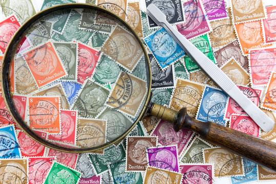 Lupe auf Briefmarken, Muenzhandel Waterstraat
