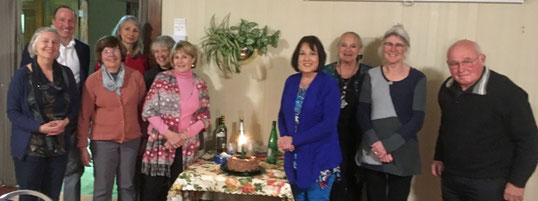 Some SweetWater Board Members and supporters are pictured here with the special 15th anniversary cake.