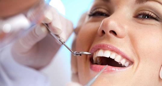 Resinas dentales, limpieza dental, extracciones dentales.