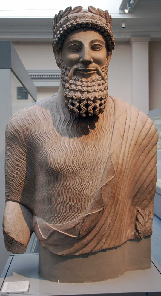 Colossal limestone statue of a clothed bearded man from the sanctuary of  Apollo-Reshef in the city-kingdom of Idalion 450 BC: British Museum wearing chiton (short-sleeved tunic) and himation (cloak)