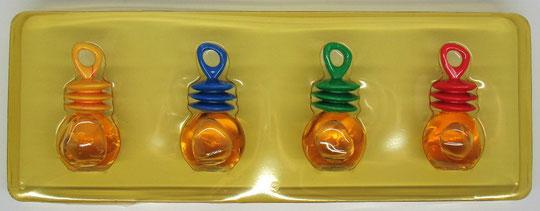 COFFRET NAF NAF COMPORTANT 4 MINIATURES AVEC BOUCHON PLASTIQUE DE COULEUR DIFFERENTE