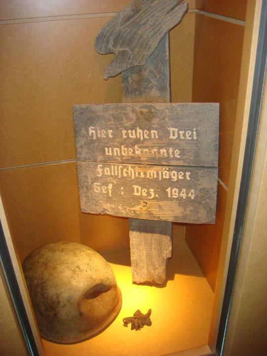 German Fallschirmjaeger grave marker and battle damaged jump helmet