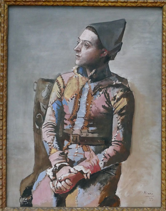 P. Picasso : Arlequin assis, 1923