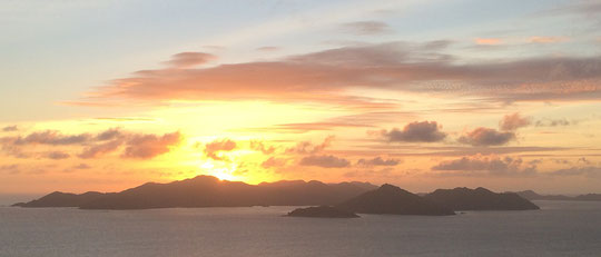 Sunset over Praslin as seen from la Digue.