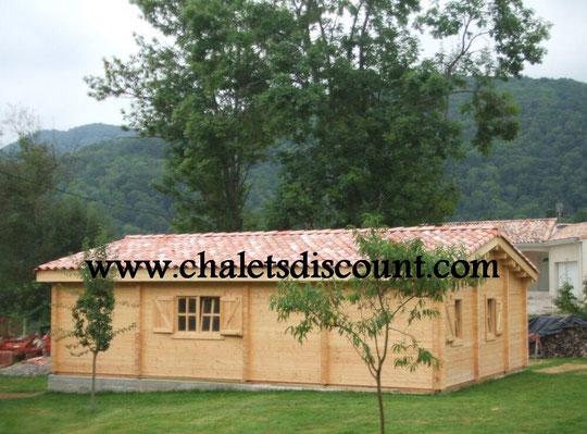 Video photos montage vente de chalet en kit maison for Montage maison en bois