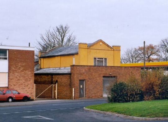 The former chapel and school in the 1990s. The petrol station had appeared by 1968 on the site of earlier houses. The chapel was demolished in 2012.