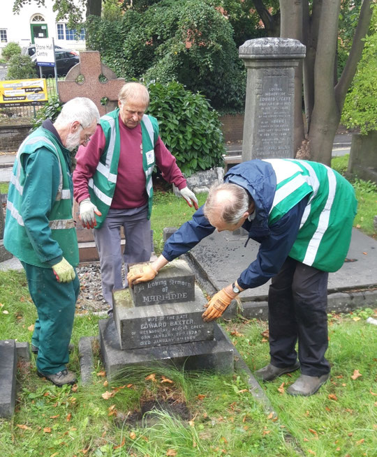 Volunteers from Acocks Green in Bloom who are working on the graves at St. Mary's put the final touches to repositioning the Baxter memorial