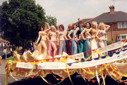 Stone Hall's float in the Acocks Green Carnival procession, adorned by the belly dancing class, 4th July 1987