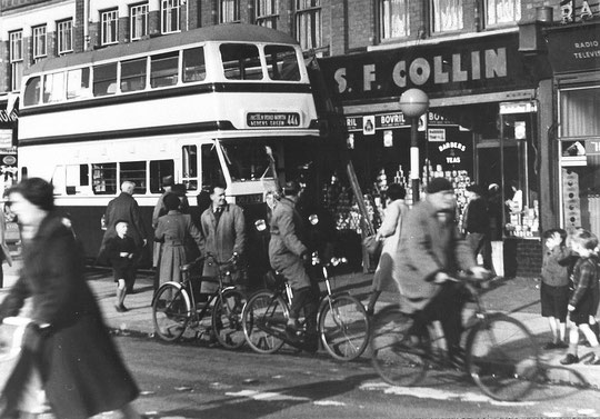 A bus accident c. 1955. Amazingly the shops were not hit (Mike Wood). S.F. Collin was at 1176.