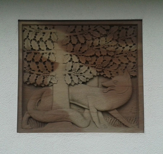 William Bloye's Fox and Hollybush sandstone bas-relief plaque in the wall of Lidl