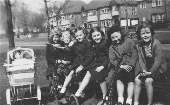 Girls on a bench at Greenwood Avenue, c. 1953. The clothing, the expressions on the girls' faces and the pram all show that this time was more innocent for girls of this age. Thanks to Sally Saunders for this photo