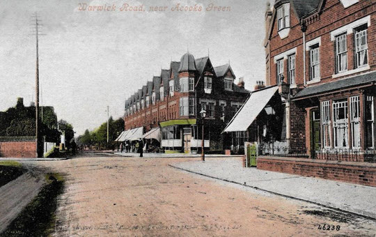 Only one of these buildings is a shop in this postcard of c. 1905