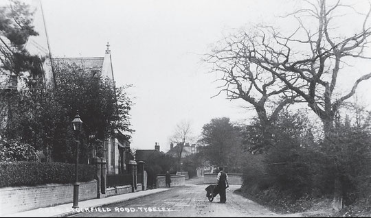 The church and new schoolroom with the original railway bridge on the unwidened road, c. 1905