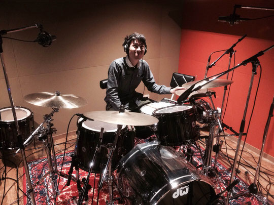 Gen sitting at his drums in the studio