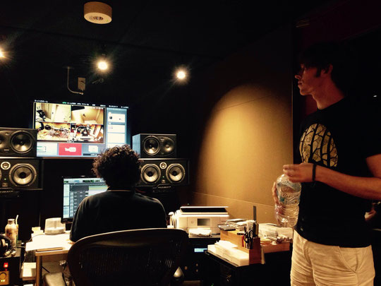 Cameron in the control booth of the recording studio