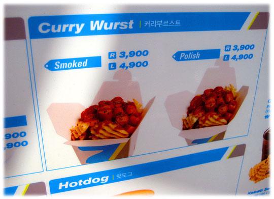 This photo is about the german curry wurst. You see the wurst in smoked or polished variation. Bild einer deutschen Currywurst mit Darm oder ohne Darm in einem Imbiss