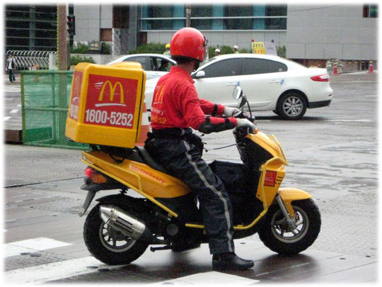 Photo about a Mc Donalds delivery service. Picture was taken in Seoul at the Gangnam area. Bild von einem McDonals Lieferservice in Südkorea. Essen to go und Fast Food auf Rädern.