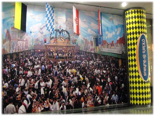 Photo about the munich oktoberfest and many people drinking German beer. It is a restaurant in Seoul. They serve Bratwurst and Sauerkraut and German beer. Oktoberfest in München.
