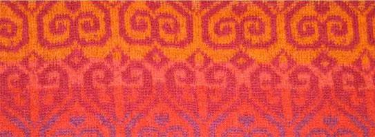 Strickmuster in Rot-Orange Farbtönen