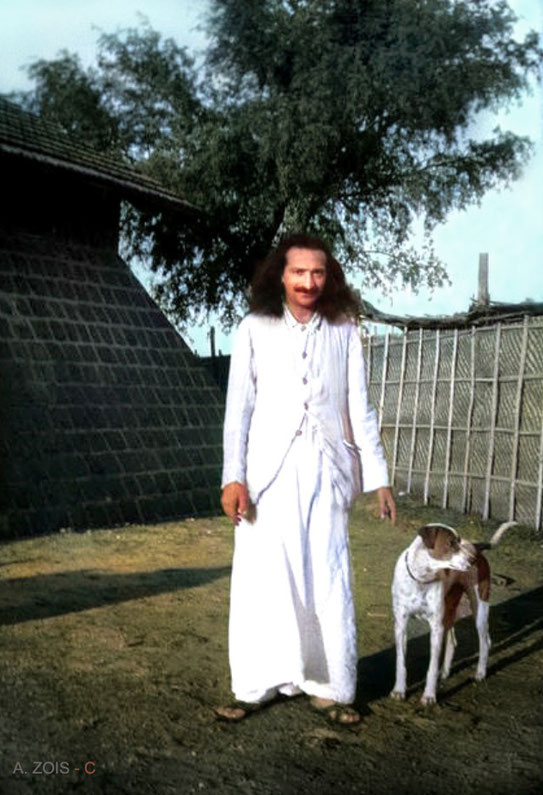 13. Meher Baba at Upper Meherabad, India with his dog Chum in 1935.