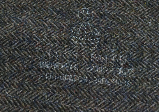 The Orb Trademark on brown Harris Tweed