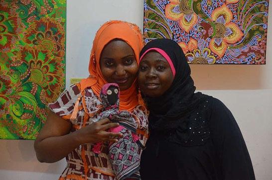 Jamila Mataka (left) with Najma Ameir Khamis from the Hurumzi Henna Art Gallery