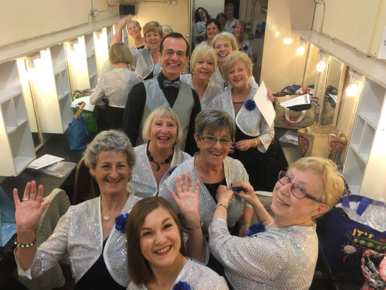 Wessex Chorus choir laughing in a dressing room.