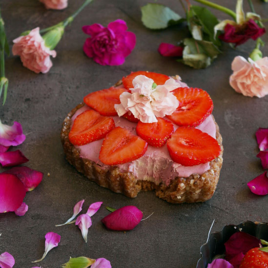 Raw vegan cake with raspberry cream and almond crust