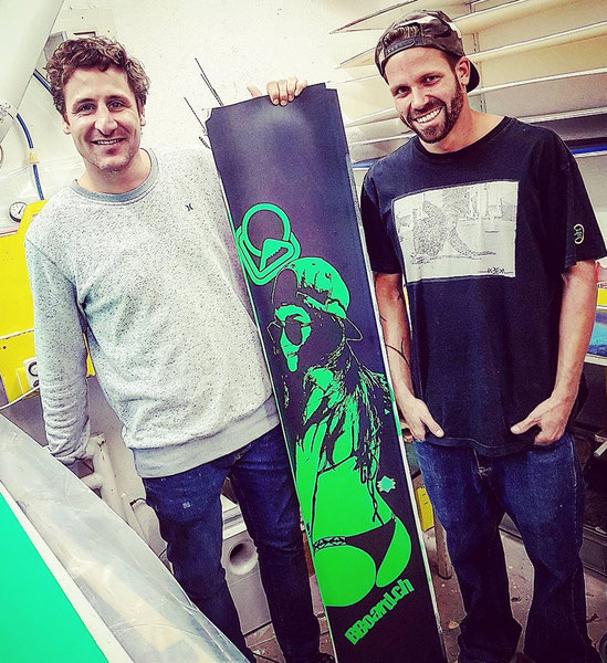 Members of the BBoard.ch Crew with one of their latest customized Snowboards