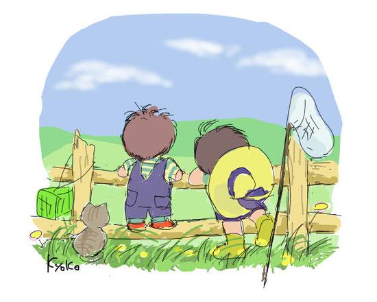 牧場で遊ぶ少年