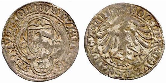 Stadt Nürnberg unter Kaiser Friedrich III., Halbschilling (ab 1465). Silber. Durchmesser ca. 21 mm. Gewicht 1,25 g. Stadtwappen im verzierten Vierpass/Adler. (Foto: Auktionshaus Lanz Auktion 124, 2005, Nr. 1742)