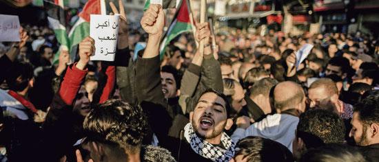 Des partisans du PFLP exigent, à Gaza en février, des efforts de reconciliation entre le Fatah et le Hamas. M. Talatene/AFPforum
