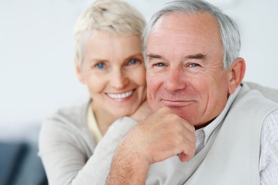 smiling older couple who know protecting your retirement will make you happy
