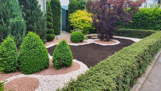 Vorgarten mit Kieselsteinen gestaltet
