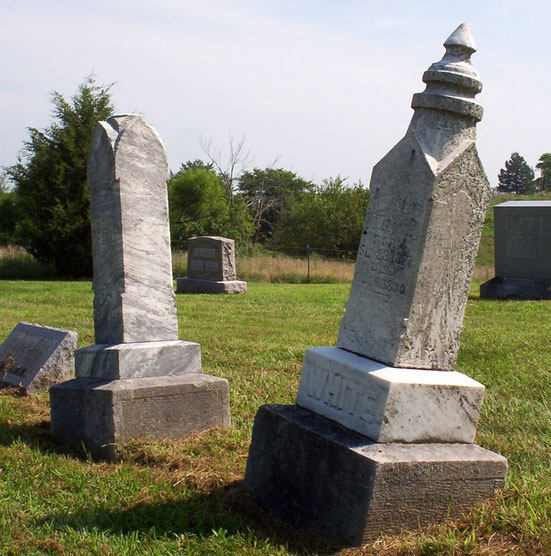 Markers for Francis (left) and Jessie White, the first burials in Central Cemetery in 1890.