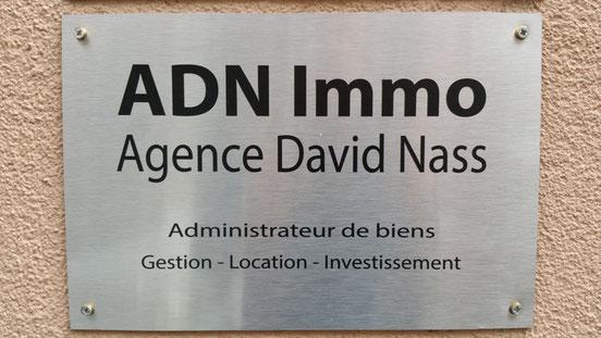 Plaque extérieur : ADN Immo : Administrateur de biens